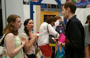 Co-Founder Ian Spangler talking to some fans